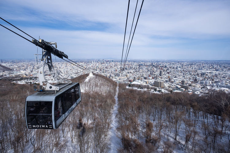 Sky Architecture Built Structure Nature Building Exterior Cloud - Sky No People Day Cable City Transportation Mode Of Transportation Connection Cable Car Technology Building Overhead Cable Car Outdoors Residential District Winter Cityscape Electricity  Sapporo Hokkaido Japan