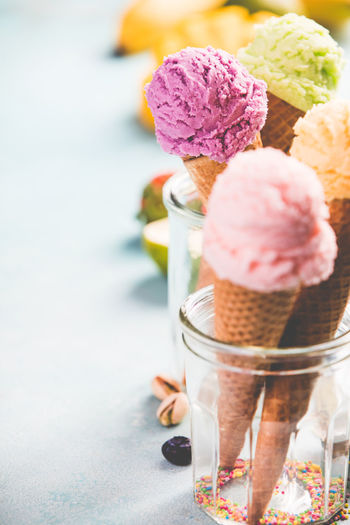 Close-up of ice cream cones in containers on table