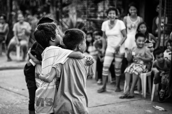 Casual Clothing Children Focus On Foreground Group Of People Leisure Activity Memories Person Philippines Playing Selective Focus Street Street Photography Streetphotography