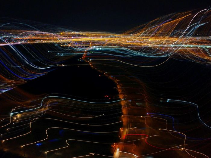 Light trails against sky at night
