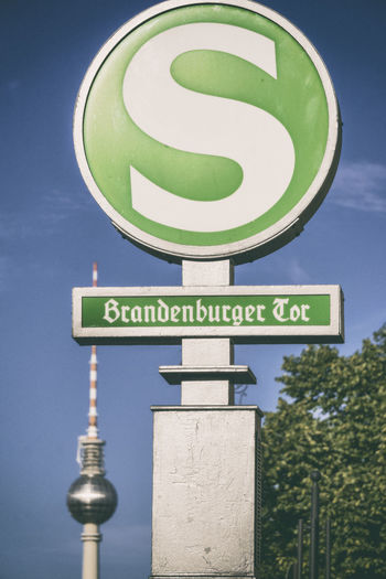 S-Bahn sign 'Brandenburger Tor' with TV Tower in background Berlin Germany 🇩🇪 Deutschland Horizontal S-Bahn Sign TV Tower Tree Brandenburger Tor Close-up Color Image Communication Day Direction Guidance Low Angle View No People Number Outdoors Road Sign Sky Text Vertical