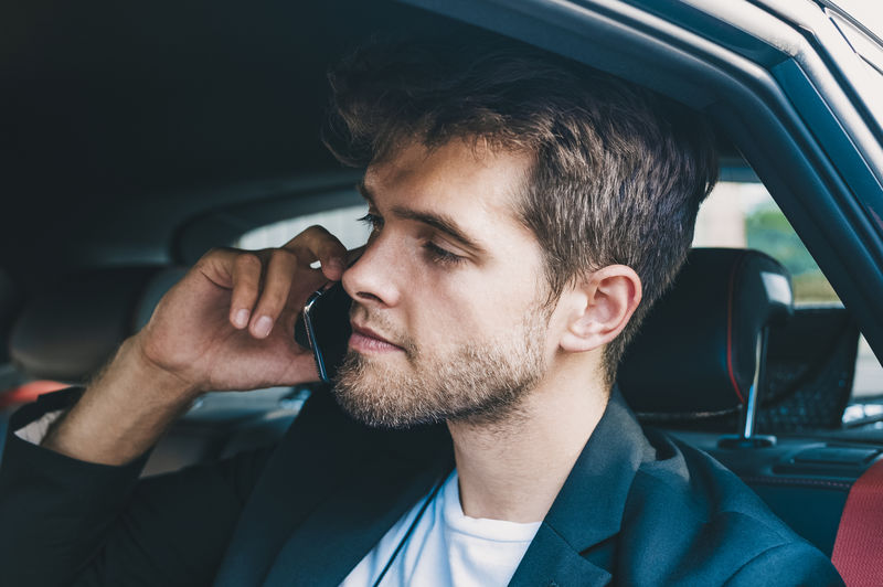 Close-up of man talking on mobile phone