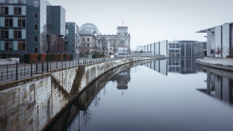 Reichstagufer Berlin during winter Architecture Berlin Building Exterior Built Structure Business Finance And Industry City Cityscape Clear Sky Day Fineart Government Building Government District Longexposure Muted Colors No People Outdoors Philipp Dase Reflection Reichstag River Sky Spree River Berlin Travel Destinations Urban Skyline Discover Berlin