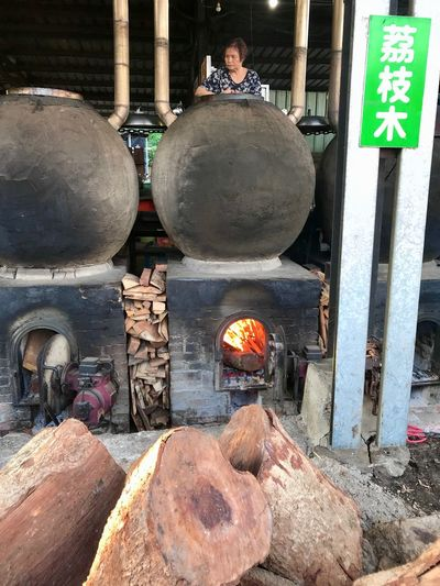 Heat - Temperature Burning Day Nature Solid Preparation  Outdoors Fire Container Fire - Natural Phenomenon Metal People Flame Place Of Worship Rock Real People Belief Kitchen Utensil Built Structure