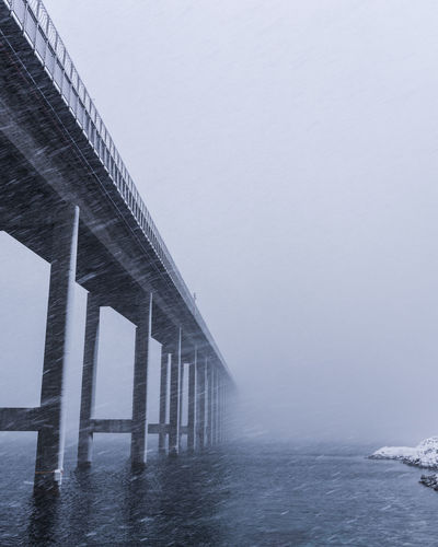 Tromso island bridge during a snowstorm City Moody Sky Norway Stormy Weather Architecture Beauty In Nature Bridge Bridge - Man Made Structure Built Structure Clear Sky Connection Day Horizon Over Water Nature No People Outdoors Sea Sky Snow Snowing Transportation Underneath Urban Urbanphotography Water