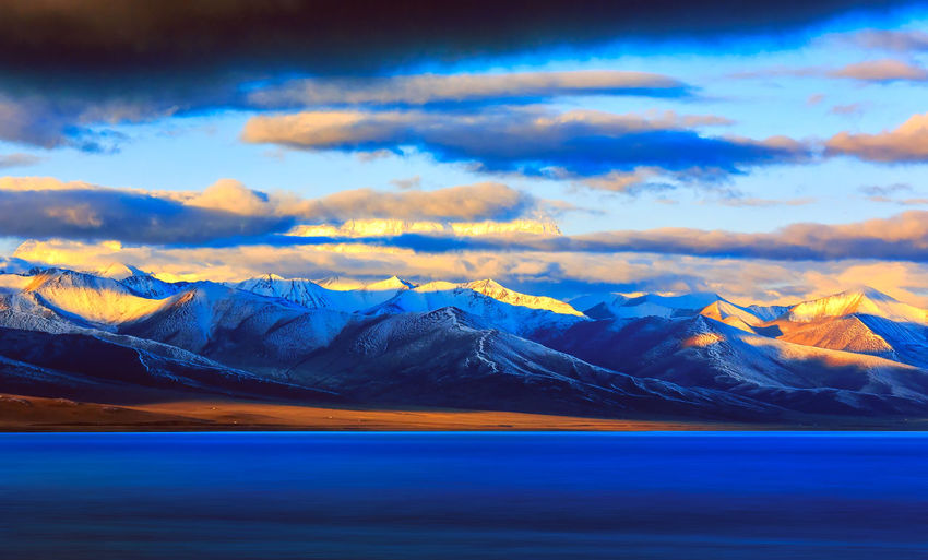 Sunrise at Nam lake, Tibet, China Background Beautiful Beauty In Nature Blue Clear Cloud Cold Temperature Colorful Destination Environment Ice Lake Landscape Mountain Nature No People Peaceful Peak Scenics Sky Snow Tourism Tranquil Travel Water