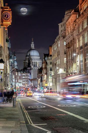 View to the St. Pauls Cathedrale in London from Fleet Street with blurred traffic and people Architecture Building Exterior City Built Structure Street Illuminated Motion Night Transportation Road Mode Of Transportation Building Blurred Motion City Street Speed Travel Destinations City Life Long Exposure Religion Light Trail Outdoors Place Of Worship London St. Paul's Cathedral Fleet Street Urban Moon Sky Double Decker Bus United Kingdom Streetphotography