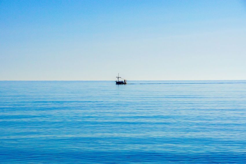Beauty In Nature Blue Blue Sea Blue Sky Boat Clear Sky Day Fisher Boat Horizon Over Water Minimalism Minimalistic Nature Nautical Vessel No People Outdoors Scenics Sea Ship Sky Tranquil Scene Tranquility Water