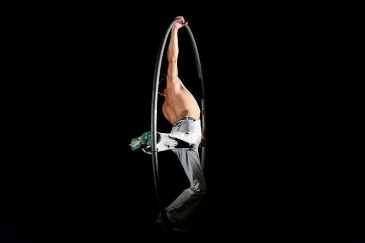 Circus Adult Balance Black Background Body Part Copy Space Cut Out Exercising Flexibility Full Length Healthy Lifestyle Human Body Part Indoors  Lifestyles One Person Practicing Sport Sports Clothing Strength Studio Shot