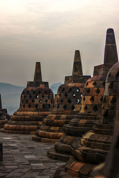 Photo from my recent trip to Borobudur temple, in Yogyakarta, Indonesia. Borobudur, is a 9th-century Mahayana Buddhist Temple. Built during the reign of the Sailendra Dynasty, abandoned following the 14th-century decline of Hindu kingdoms in Java and the Javanese conversion to Islam.A UNESCO World Heritage Site. Don't ever come here on raining season (like I did in Dec), most of the time just misty and cloudy. Would repeat the trip next year probably in April. Ancient Ancient Architecture Ancient Civilization Architecture Architecture_collection Borobudur Borobudur Temple Buddhism Buddhist Temple EyeEm Indonesia Fredpius Historical Monuments Magelang Stupa Sunrise Yogyakarta