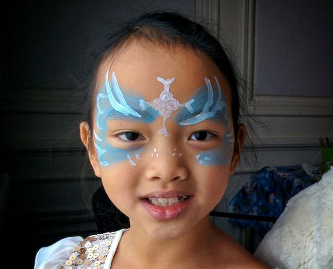 Close-up Portrait Of Asian Girl In Face Paint