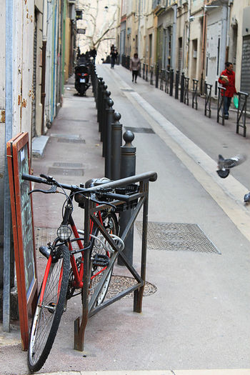 a bike standin in front of an alley in Le Panier, Marseille Alley Alternative Bicycle Bike Celebrate Your Ride Fahrrad Le Panier Lifestyle Metal Pause Street Transportation Urban Wheels