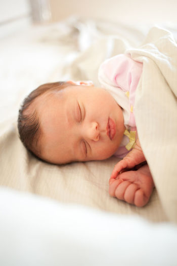 Newborn baby girl sleeping in bed. New Born Babies Only Baby Babyhood Bed Beginnings Childhood Close-up Cute Day Eyes Closed  Fragility Indoors  Innocence Lying Down New Life Newborn One Person People Real People Relaxation Selective Focus Sleep Sleeping Sleepping My Best Photo