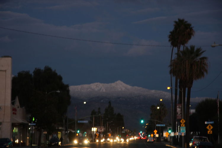 City Illuminated Tree Architecture Building Exterior Sky Built Structure Plant Nature Street No People Cloud - Sky Mode Of Transportation Transportation Night Car Tropical Climate Motor Vehicle Mountain Lighting Equipment Outdoors Electricity  Light Hemet, California