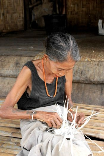 enjoy old age,weaving palm leaves to make a container for storing rice Thank You Eyeem Old Woman Enjoying Life Eyeem Galery Protecting Where We Play And Live Sumba Timur Picturing Individuality Beautiful Day Humba Ailulu Handmade The Week On Eyem Kamanggi Village