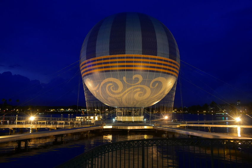 Orlando, Florida; August 19, 2018 Beatiful sky blue and iluminated air balloon at Lake Buena Vista Walt Disney World DisneyWorld Disney Hotels Balloon Disney Store Taxi Boat Mickie Mouse Coca Cola Planet Hollywood Restaurant Art Decor Shopping Rollercoaster Disney Springs Attraction Theme Park Boardwalk Fireworks Summer Show Travel Tourism Italian Food Latin Food Magic