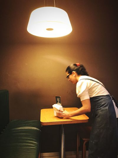Indoors  Real People Young Adult Three Quarter Length One Person Young Women Casual Clothing Lifestyles Illuminated Day People Restaurant Bar Waitress Waitress At Work Cleaning