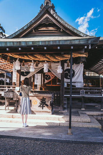 Worship Inuyama Japan Japanese  Shrine Travel Trip Woman Worship Architecture Building Exterior Built Structure Culture Day Devout Lifestyles Real People Religion Religious  Street Photography Sunlight Tour Young Adult 日本 犬山 The Traveler - 2018 EyeEm Awards