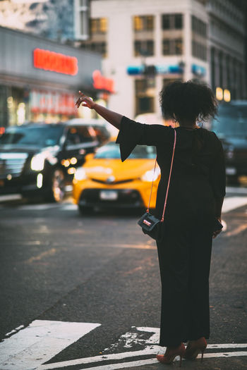 Woman standing on street