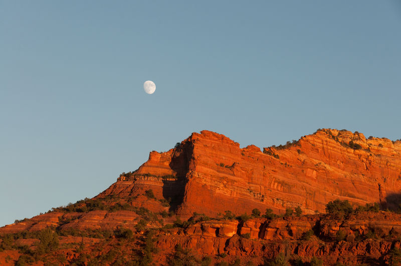 Yesterday's moon, from a moving car. Arid Climate Arid Landscape Astronomy Beauty In Nature Blue Sky Clear Sky Day Desert Landscape Moon Nature No People Outdoors Red Rocks  Rock Formation Scenics Sky Tranquility Travel Destinations