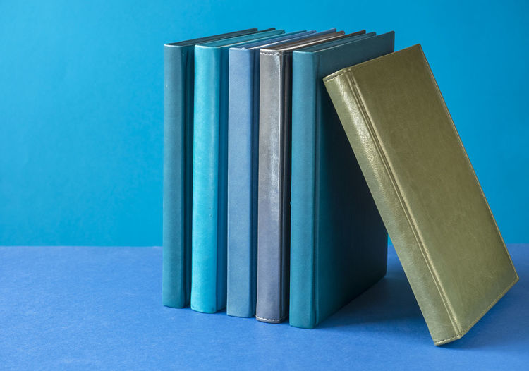 Close-up of books on blue table