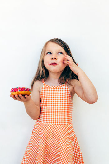 this little girl is deeply in love with her donut Donut Donuts Portrait Child Females Chherful Dessert Eating Tasty Love Real People Doughnut Sweet Lifestyles Caucasian Happy Happiness Little Summer Diet Sugar Unhealthy Eating Junk Birthday Funny Fat Hair Joy Joyful Calories Sweety  Snack Kid Holding Kiss Childhood One Person White Background Indoors  Studio Shot Girls Front View Looking At Camera Standing Women Three Quarter Length Food And Drink Innocence Food Hairstyle