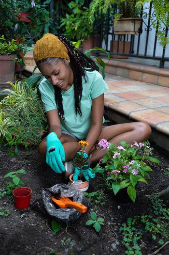 Full length of happy girl in flower pot