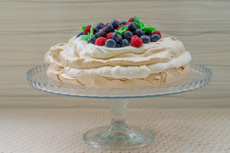 Close-up of pavlova cake on stand