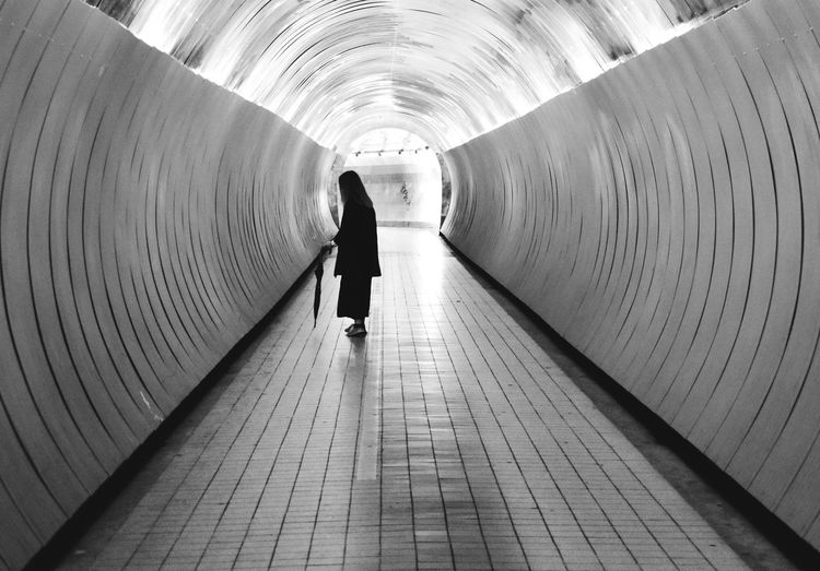 Blackandwhite The Way Forward Direction Real People Full Length Lifestyles Rear View Walking One Person Architecture Leisure Activity Built Structure Indoors  Wall - Building Feature Light At The End Of The Tunnel Tunnel