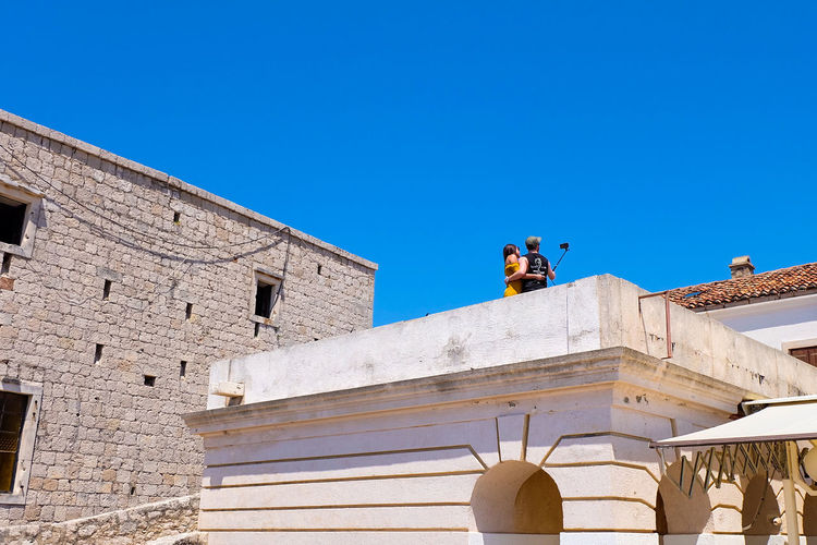 Tourists Photography Selfie ✌ Landscape Photographer Adventure Exploring View Scenic Experience City Blue King - Royal Person Sculpture Architecture Sky Building Exterior Fort Ancient Civilization Fortified Wall