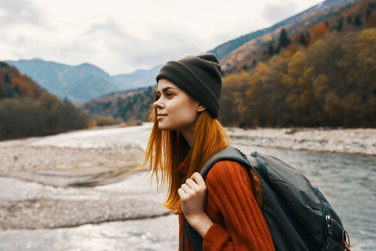 Beautiful young woman standing on mountain