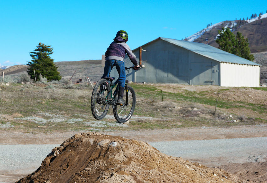Bicycle Bieksa Bike Built Structure Catching Air Childhood Chilling Dirt Jump Full Length Jumping Spider Kid Land Vehicle Leisure Activity Lifestyles Mode Of Transport Mountain Mountain Bike Mountain Biking Mountains Mountains And Sky Transportation