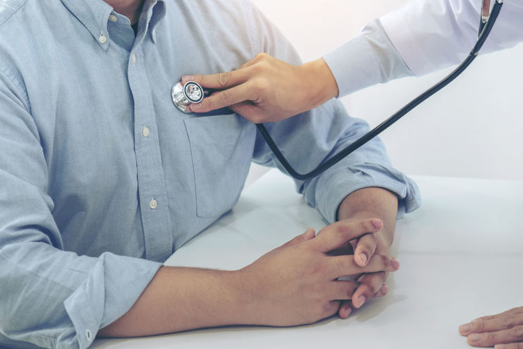 Cropped image of doctor treating patient