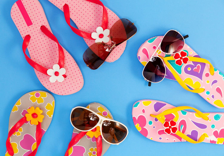 Blue Blue Background Choice Close-up Colored Background Directly Above Fashion Floral Pattern Glasses High Angle View Holiday Indoors  Multi Colored No People Pattern Personal Accessory Polka Dot Shoe Still Life Sunglasses Table Variation
