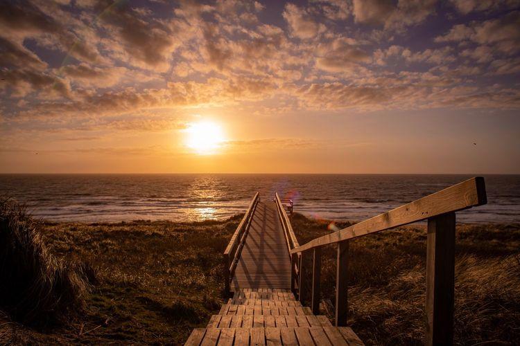 Sylt Sylt EyeEm Selects Sky Water Sea Sunset Scenics - Nature Horizon Over Water Horizon Beauty In Nature Beach Cloud - Sky Tranquil Scene Land Tranquility Nature Sunlight Idyllic Non-urban Scene No People Sun Outdoors