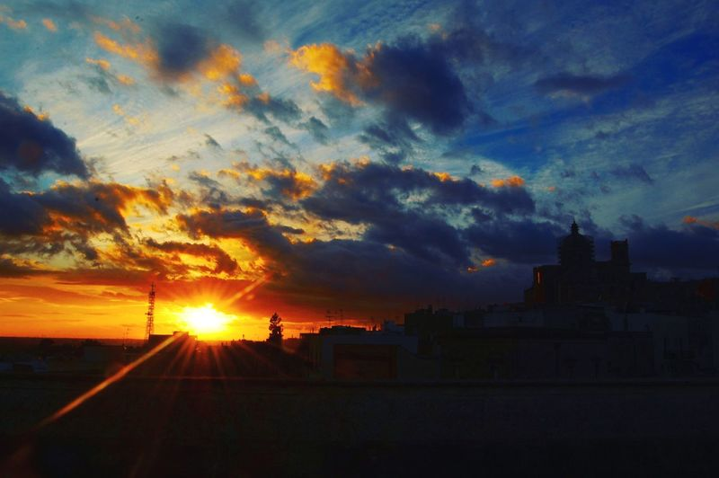 Sunset over the city Nature Wind Color Travel Streetphotography Street Cloudy Day Cathedral Shadow Sunrays Reflection_collection Orange Sky Sky_collection Colors Of Nature Urban Skyline Urbanphotography Sunset Silhouette Dramatic Sky Sky Cloud - Sky