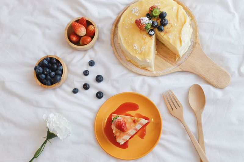 Tasty crape cake Flower Wooden Tray Cake Food Photography Strawberry Blueberry Cafe Bakery Tasty Crape Cake EyeEm Selects Food Food And Drink Fruit Freshness Sweet Food Berry Fruit Ready-to-eat High Angle View Indoors  Wellbeing Indulgence Blueberry Directly Above Plate Spoon Dessert Sweet Kitchen Utensil Eating Utensil