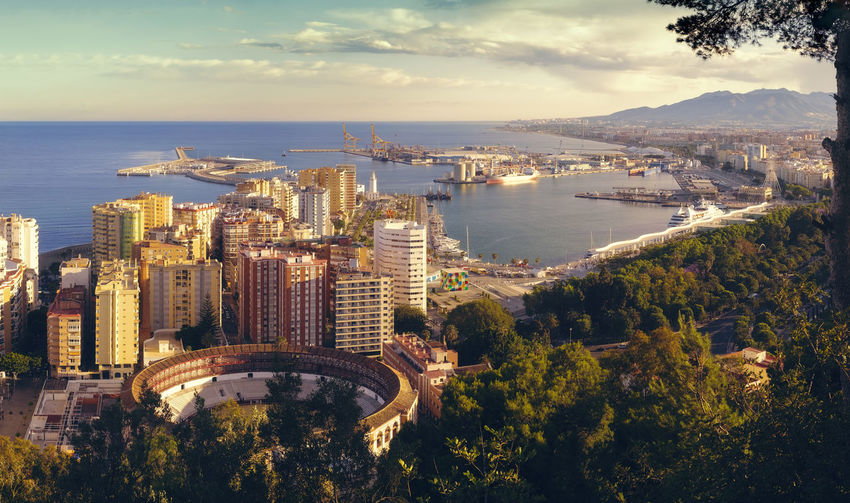 Panoramic view of the Malaga city, harbor and bullfighting arena, Costa del Sol, Malaga Province, Andalucia, Spain, Western Europe Andalucía Andalusia Bullfighting Arena Cloudy Day Cruise Ship Harbour View Luxury Hotel Malaga Mediterranean Sea Palm Tree Panorama SPAIN Tourist Attraction  Building Exterior Costa Del Sol Destination High Multiple Image Panoramic Photography Port Roberto Sorin Shipping  Tourism The Great Outdoors - 2018 EyeEm Awards The Traveler - 2018 EyeEm Awards