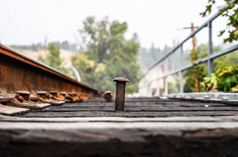 Close-up of rusty railroad track against clear sky
