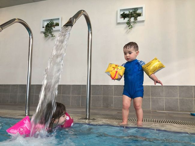Childhood Playing Child Water Fun Boys Children Only Swimming Pool Spraying One Person Lifestyles Indoors  Leisure Activity Enjoyment Front View Elementary Age Day One Boy Only People
