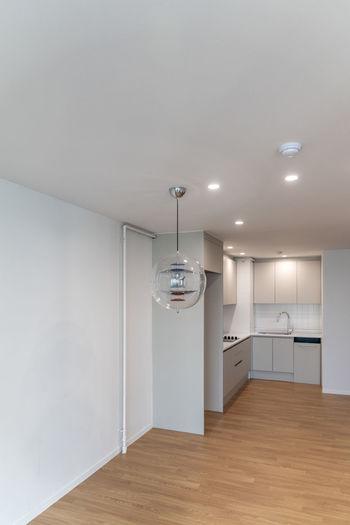 Illuminated lamp on wall at home