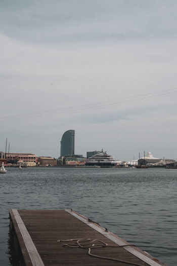 Pier over sea against buildings in city