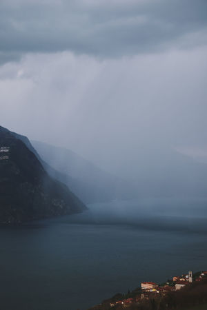 Wall of Rain Rain Rainy Days Wall Of Rain Beauty In Nature Blue Cloud - Sky Clouds Clouds And Sky Iseo Lake Italy Italy🇮🇹 Lake Lake View Mountain Nature No People Outdoors Scenics - Nature Sky TOWNSCAPE Tranquility Water Waterfront