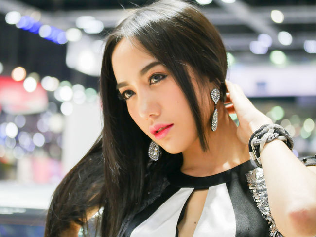 Bangkok Bangkok Thailand. Black Hair Long Lady Looking At Camera Motor Show Portrait Of A Woman Thai Thailand Young Asian Girl Asin Beauty Beautyful Woman Black Hair Business Finance And Industry Businesswoman Long Hair Portrait Women women around the world Women Thai Young Adult Young Adults