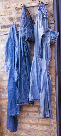 Out to Dry Blue Blue Jeans Bricks Clothes Denim No People Outdoors Urban Life Ripped Jeans Wash Drying Clothes Torn Jeans Torn Clothing EyeEmNewHere Live For The Story
