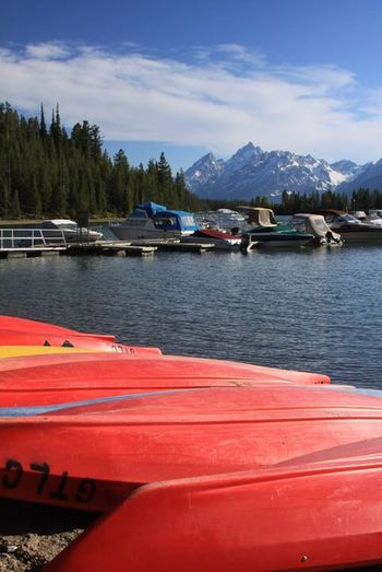 Grand Tetons National Park Beauty In Nature Day Kayak Lake Moored Mountain Mountain Range Nature Nautical Vessel No People Outdoors Red Scenics Sky Tranquil Scene Tranquility Transportation Tree Water