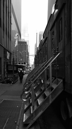Typical scenery around the streets of Manhattan. Take one!!🎬📽️ City Scapes Sidewalk Steps/stairs Photography Black And White One Person Movie Trailers City Road Sky