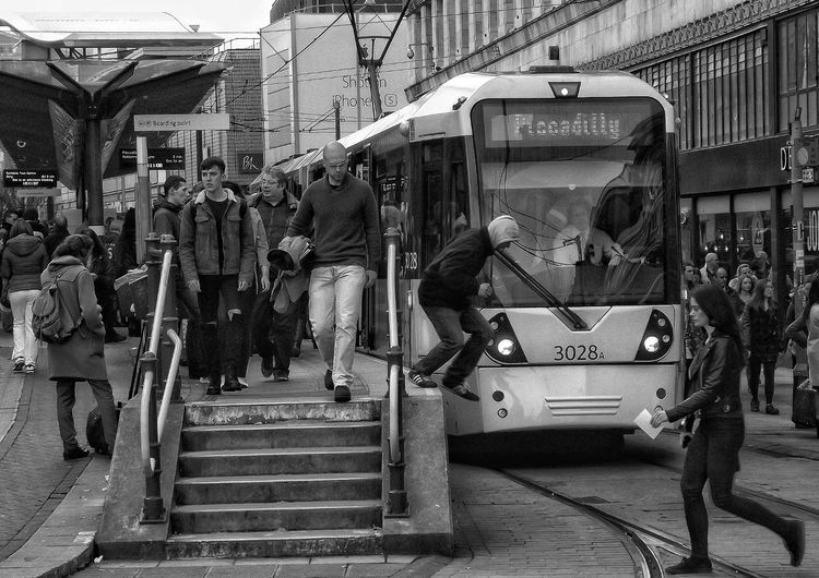People By Cable Car At Railroad Station Platform