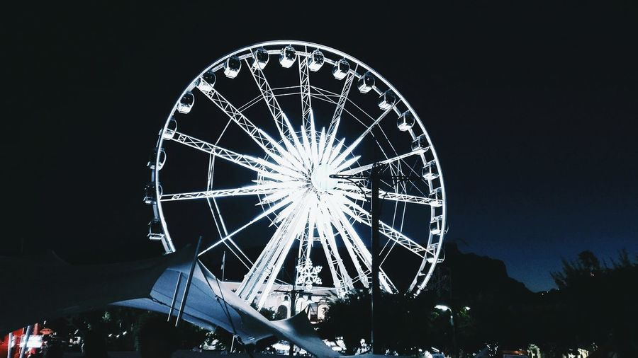 The circle of life Arts Culture And Entertainment Night Illuminated Ferris Wheel Outdoors No People Sky Close-up The Secret Spaces EyeEm Diversity Resist Welcome To Black EyeEmNewHere