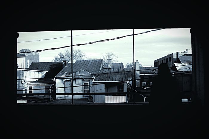 """""""An image of a person, an object or scene consisting of the outline and a featureless interior, with the silhouetted object usually being black."""" Silhouette Definition Blackandwhite Window City Car Garage Person ThoughtProvoking"""